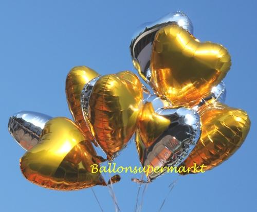 Goldene und Silberne Herzluftballons aus Folie mit Helium-Ballongas