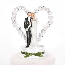 Brautpaar vor Rosenherz, weiss, Dekoration Hochzeitstorte