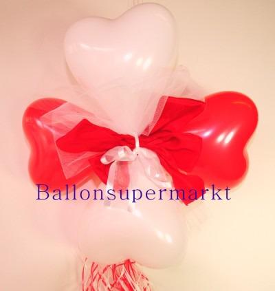 Ballondekoration-Herzballons-mit-Ringelband-und-Zierschleife-in-Rot-Weiss