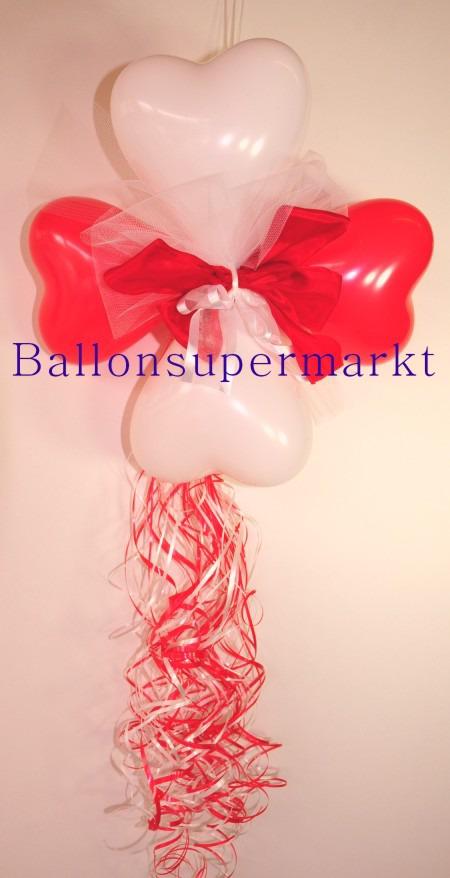 Dekoration-aus-Herzluftballons-mit-Zierschleife-Farben-Rot-Weiss