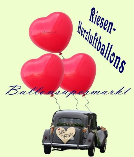 Riesen-Herzluftballons-Rot-350er-am Hochzeits-Fahrzeug