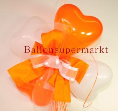 Ballondekoration-Herzballons-mit-Ringelband-und-Zierschleife-in-Orange-Weiss