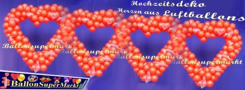 Hochzeit-Dekoration-Herz-aus-Luftballons-Farbe-Rot-mit-Tuellstoff